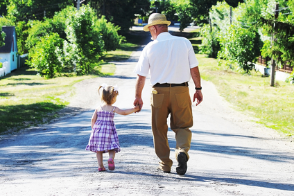 Grandfather walks with Granddaughter
