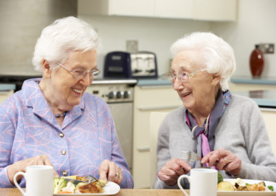 Senior women enjoying meal together